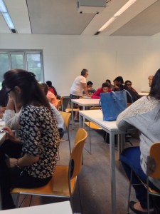 Students engaged in class activity at HEC Belgium